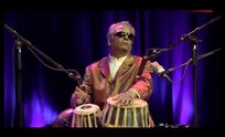 Baluji playing the sitar