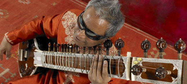 Baluji playing sitar