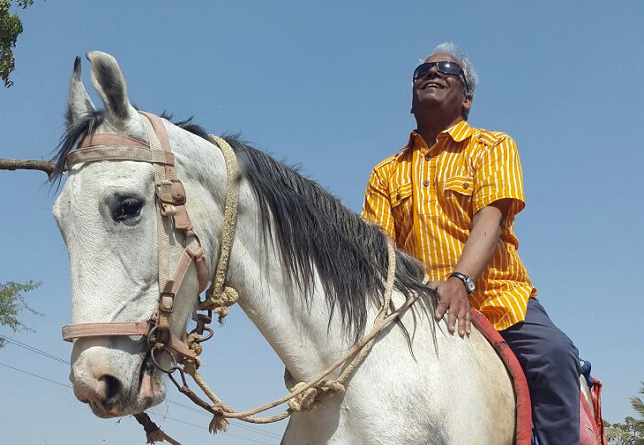 Baluji riding a horse Re: Imagine India
