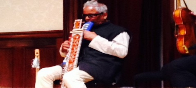 Baluji playing melodica and sitar at Wigmore Hall